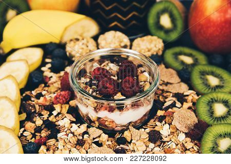Healthy Breakfast Fresh Granola Muesli With Berries And Fruits In A Glass Jar.
