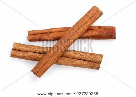 Cinnamon Sticks Isolated On White Background. Top View.