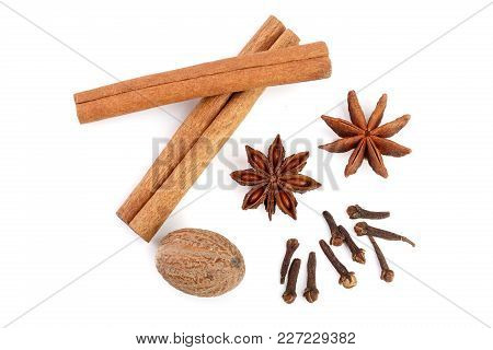 Cinnamon Sticks With Star Anise, Nutmeg And Clove Isolated On White Background. Top View.