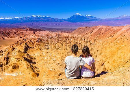 View On Couple Enjoying View Of Death Valley An Volcano Licanbur By San Pedro De Atacama