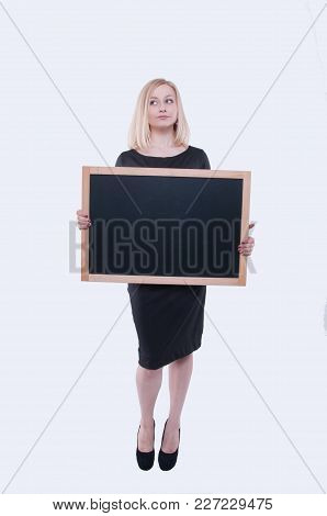 Business Woman With Chalk Board In Black Dress Isolated On White Background. Young Blonde Girl Holdi