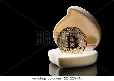 Golden Bitcoin Coin In Wedding Ring Box Isolated On Black Background With Reflection And Copy Space