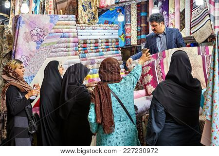 Tehran, Iran - April 29, 2017: Islamic Women Dressed In Religious Veil  Chooses Fabric In Tehran Gra