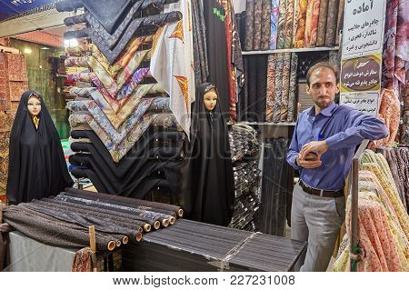 Tehran, Iran - April 29, 2017: One Fabric Trader And Two Female Dummies In Islamic Clothing Are Stan