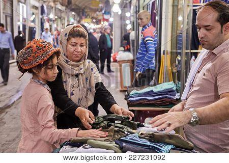 Tehran, Iran - April 29, 2017: Iranian Family On Tehran Grand Bazaar, Mother And Daughter Choose Clo