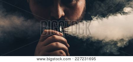 Man Vaping E-cigarette With E-liquid, Exhales Large Clouds Of Steam From Vape Device Or Dripping Rda