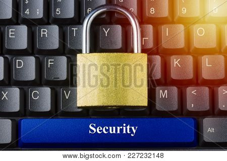Padlock On Keyboard With Blue Space Button And Security Inscription On It. Internet Data Privacy Inf