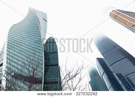 Skyscrapers In The Financial District. Modern Office Buildings Against Gloomy Sky, Low Angle View. B