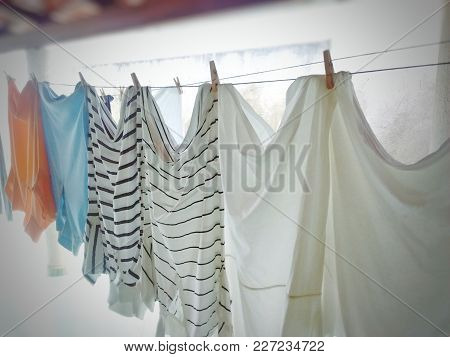Clothes Hanging On A Clothesline With A Blur Around.