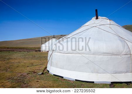 Traditional Mongolian portable round tent ger covered with white outer cover in Altai Mountains of Western Mongolia