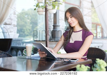 Young Woman Working With Digital Tablet At Cafe. Freelancer Working, Young Businesswoman Networking,