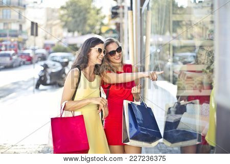 Two girls doing shopping