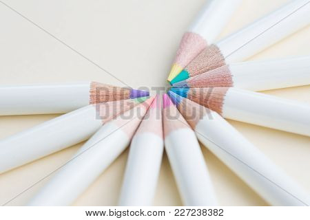 Pastel Color Pencils Arrange In Circle With Copy Space On Light White Paper Background Using As Colo