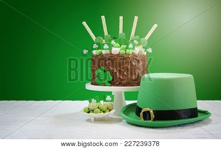 St Patrick's Day Party Table With Chocolate Cake, Leprechaun Hat And Lens Flare.