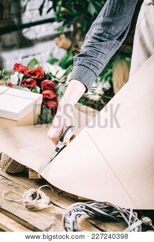 Florist Woman Making Flower Bouquet On Her Workplace