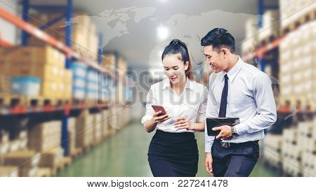 Asian Business Man And Business Woman Worker In Warehouse  Using Tablet Checking Boxes Logistic Impo