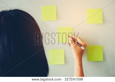 Entrepreneur Woman Putting His Ideas In Post-it Planning On New Business Project