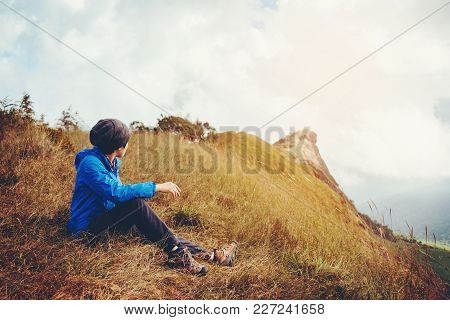 Tourist And Traveler Man With Backpack The Mountain In Forest