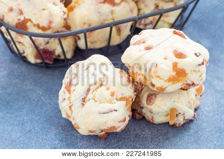 Homemade Savory Cookies With Cheese And Bacon In A Basket And On The Table, Horizontal