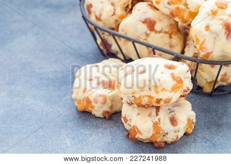 Homemade Savory Cookies With Cheese And Bacon In A Basket And On The Table, Horizontal, Copy Space