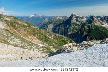 A Climber Ascends Snow Slopes On Luna Peak. Picket Range, North Cascades National Park, Washington