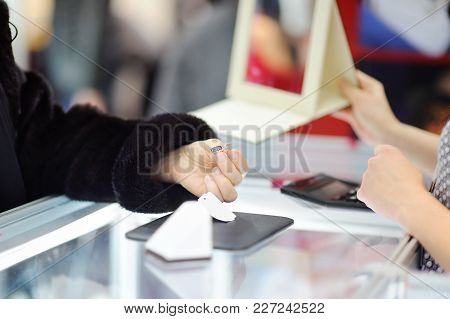 Woman Choosing The Perfect Earrings At A Jeweler, Close Up Photo