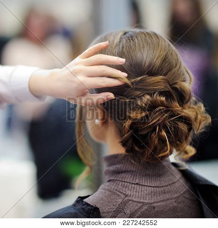 Young Woman/bride Getting Her Hair Done Before Wedding Or Party