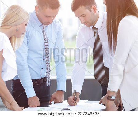 business team adjusts work plan
