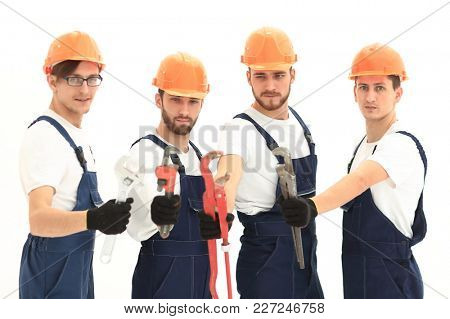 group of plumbers with working tools