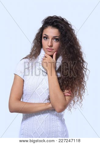 Beautiful woman with crossed arms in white dress.