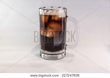 An Iced Cold Mug Of Cola Soda,