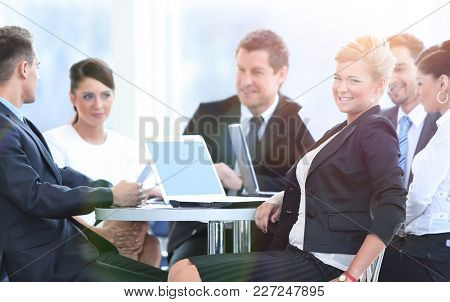 Business Team Discussing Ideas in Lounge
