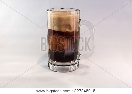 An Ice Cold Mug Of Root Beer With A Foamy Head.