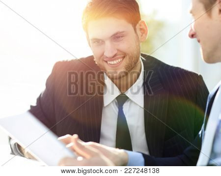 close-up.businessman talking to colleague.