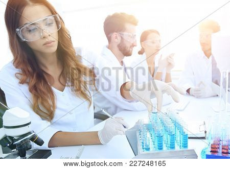 Scientists examining in the lab with test tubes.