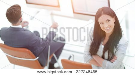 successful business woman on the background of a modern workplac