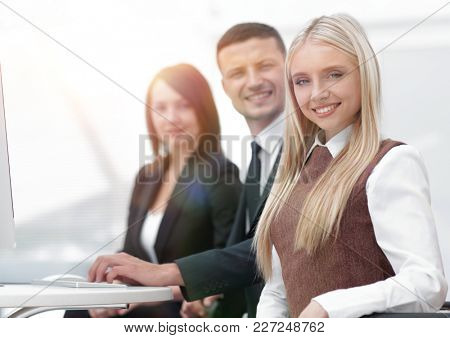 professional business team working while sitting at Desk.