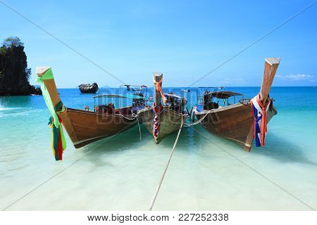 Long Tail Boats By The Shore At Koh Hong Island,  Kra Bi Andaman Sea Of Thailand Against Beautiful C