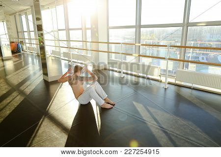 Model Diligently Rock Press, Tattooed Guy Try To Keep Fit. Handsome Male With Good Body Lie On Floor