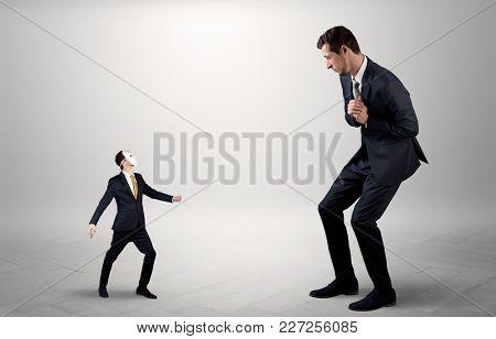Conflict between small masked businessman and big elegant businessman