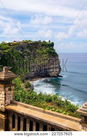 Landscape In Uluwatu Temple Bali Indonesia. Landscape Of High Cliff With Sunset Sky At Uluwatu Templ