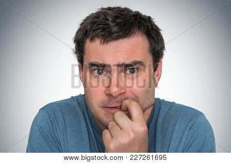Nervous Man Biting His Nails - Nervous Breakdown Concept