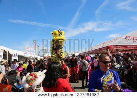 Costa Mesa CA. - 2/17/18 TET Festival featuring a Lion Dance in which performers mimic a lion's movements in a lion costume to bring good luck and fortune.