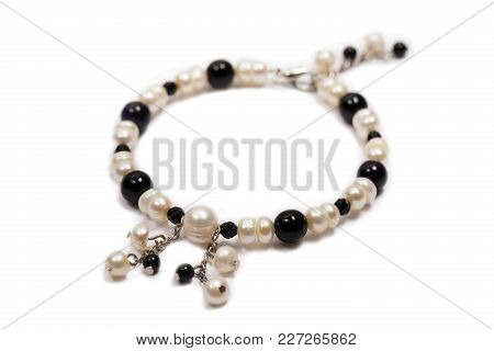 Bracelet Made Of Pearls With Metal Pendants, Isolated