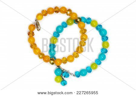 Two Bracelets Of Colored Semiprecious Stones On White