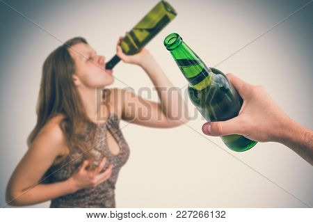 Unfocused Woman Drinking Alcohol And Hand Of Man With Beer On Gray Background - Retro Style
