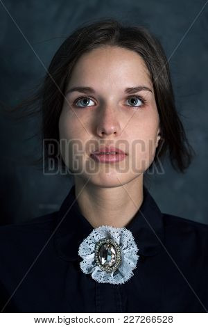 Beautiful Girl In A Vintage Dress With An Emotional Expression
