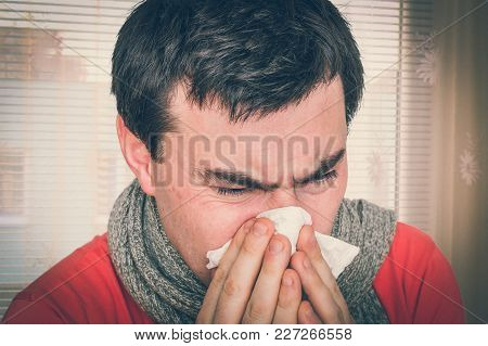 Sick Man With Flu Or Cold Sneezing Into Handkerchief - Cold And Flu Concept - Retro Style