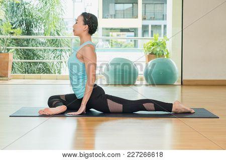 Yoga Class Studio,asian Woman Master Doing Half Pigeonpose,healthly Lifestyle Sport