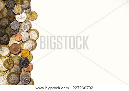 Coins, Money, View From The Top Lie On The Edge Of The Left Edge Of The Frame On A White Background